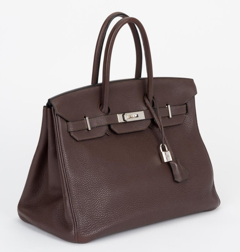 Hermes birkin 35 ebene clemence leather with palladium hardware. Date stamp K for 2007. Comes with clochette, tirette, lock, keys and original dust cover.