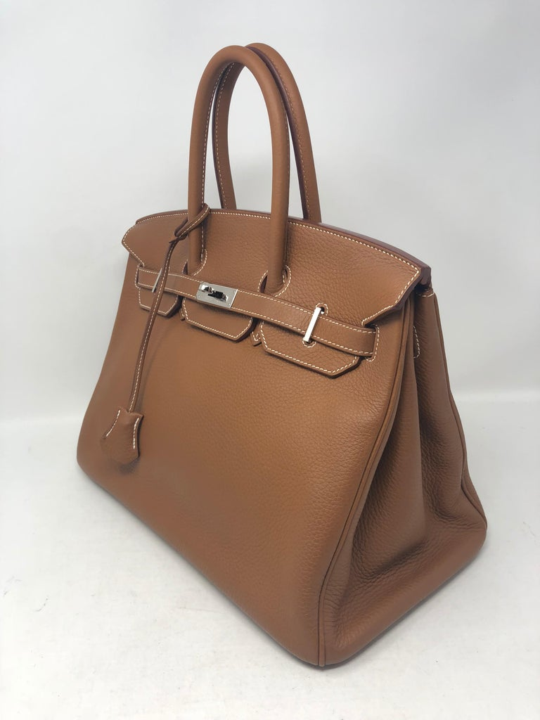 Hermes Birkin 35 Gold Color with Palladium hardware. Beautiful condition. Like new never used. The best neutral color and Hermes color. Highlt coveted and perfect size. Comes with clochette, lock and keys. Don't miss out on this one. Guaranteed