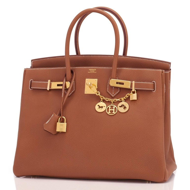 Hermes Gold Togo Camel Tan 35cm Birkin Gold Hardware New or Never Worn. Pristine Condition (with plastic on hardware).  Perfect gift! Comes with lock, keys, clochette, sleeper, raincoat, and Hermes box. Gold is a gorgeous camel tan, perhaps the most