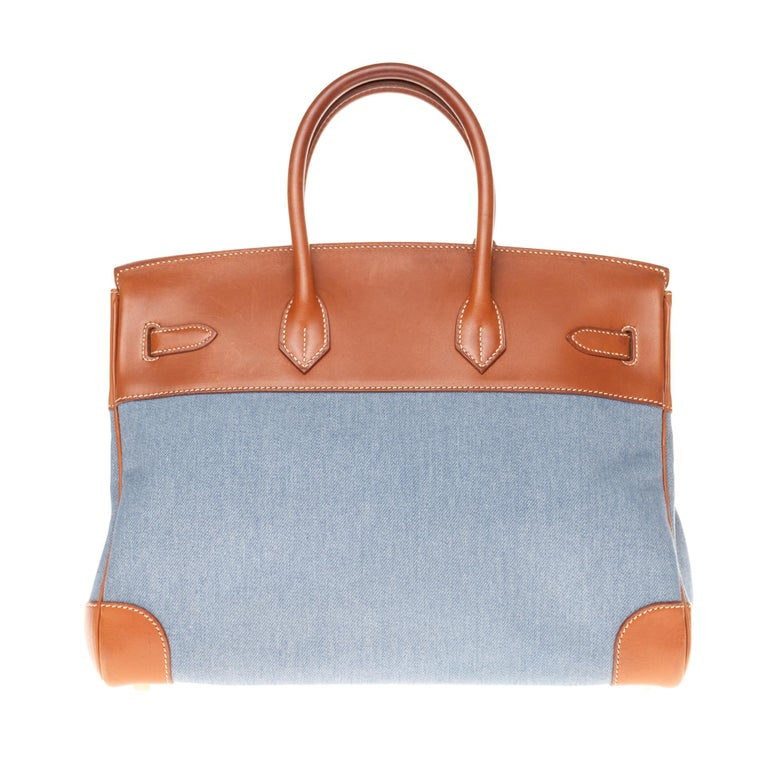 Stunning and rare Hermès Hermes 35cm Birkin in double-material brown barenia leather and blue denim , gold-plated silver metal trim, double handle in brown barenia leather allowing a handheld.  Flap closure.  Brown leather inner lining, one zipped