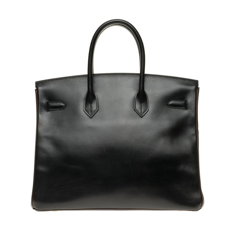 Splendid and rare Birkin 35 bicolor (special order, no horseshoe before 2010) in black & brown calfskin leather (rods and interior), palladium silver metal trim, double handle in black leather allowing a hand carrying Closure by flap Black leather