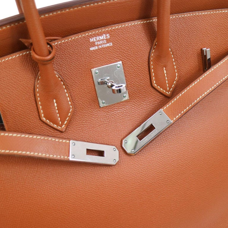 Hermes Birkin 35 Burnt Orange Red Leather Silver Carryall Travel Top Handle Satchel Tote  Leather Palladium tone hardware Leather lining Date code present Made in France Handle drop 4.25
