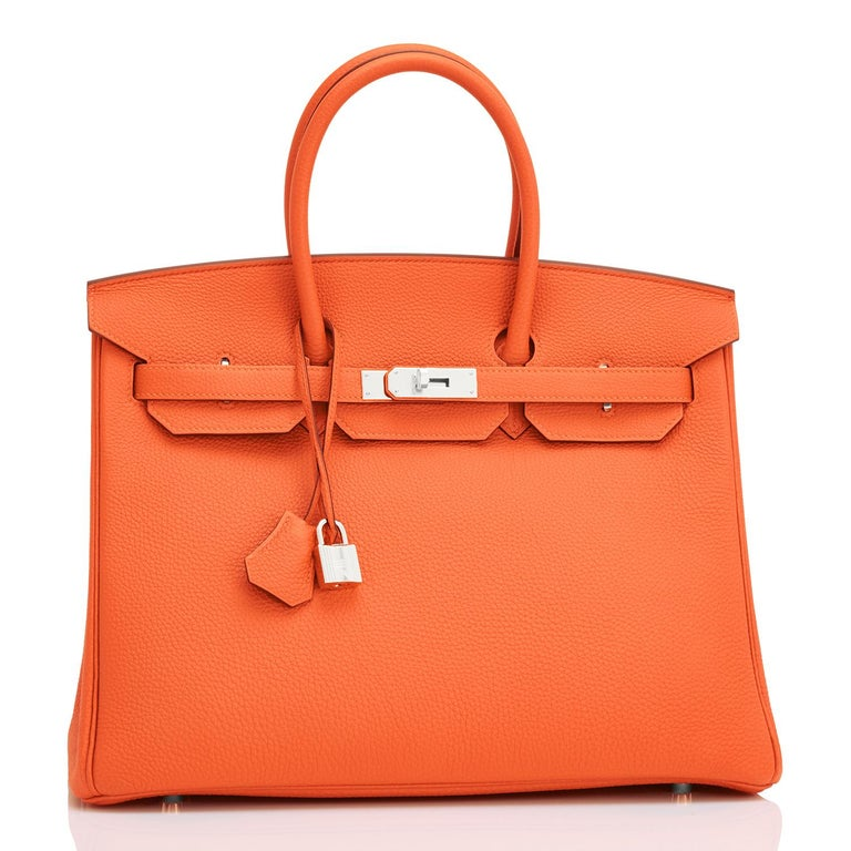 Hermes Birkin 35 Orange Feu Togo Palladium Hardware NEW Spectacularly gorgeous combination!  Feu Orange is very coveted and rare to find now. Brand New in Box. Store fresh. Pristine condition (with plastic on hardware). Perfect gift! Comes with