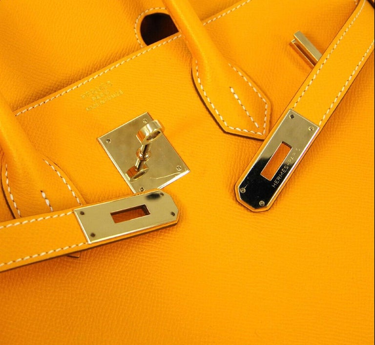 Leather Gold tone hardware Leather lining Turn-lock closure Date code present Made in France Handle drop 4