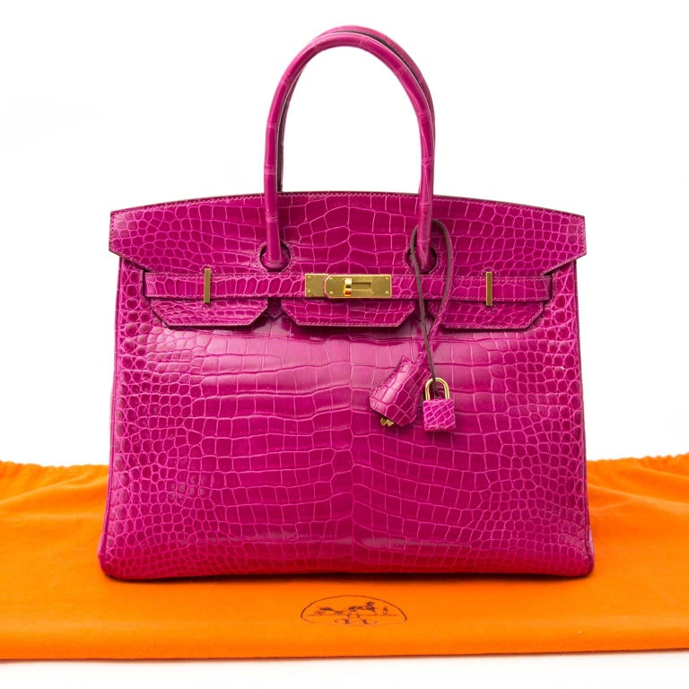 Definitely Hermès most illustrious porosus pink croc color, which is extremely hard to get!  This Hermès Birkin is incredibly rare and featured in the rose Sheherazade color, which is a stunning pink tone.  Porosus crocodile skin can be recognized
