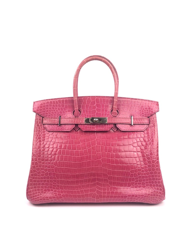Stunning Hermès Birkin 35 Rose Tyrien Pink Crocodile. Excellent Condition with plastic on hardware with some regular signs of use.   Shop with confidence from Lux Addicts. Authenticity Guaranteed!