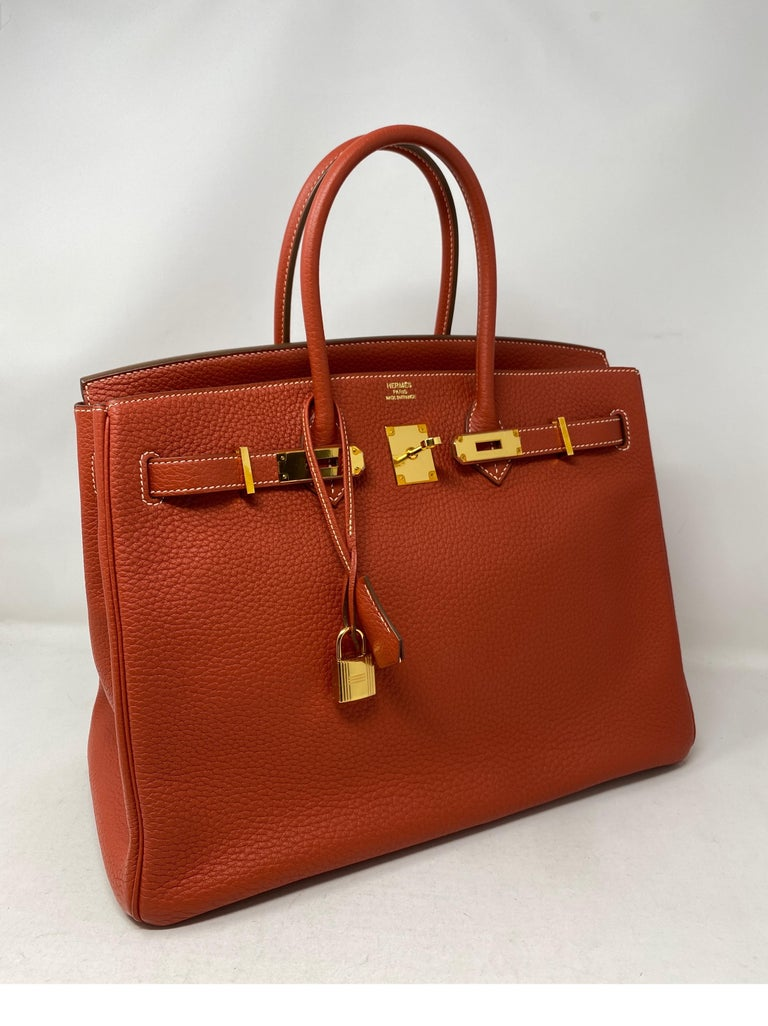 Hermes Birkin 35 Sanguine Bag. Gold hardware. Excellent condition. Plastic is still on hardware. Vintage but looks like it was never carried. Beautiful neutral color. Sanguine color is hard to find. Includes clochette, lock, keys, and dust cover.