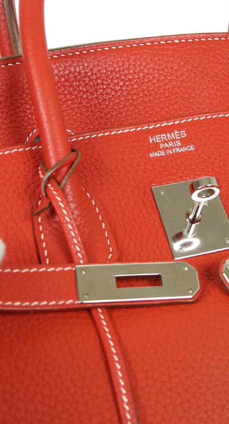 Leather Palladium tone hardware Leather lining Turn-lock closure Date code present Made in France Handle drop 4