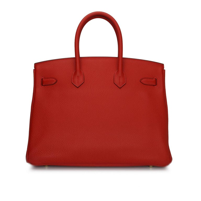 Hermès Birkin 35cm D5 Geranium Togo Leather with Gold Hardware Stamp P 2012.  This bag is still in a pristine-brand new condition. The leather still smells fresh as when new, along with it still holding to the original shape. The hardware still very