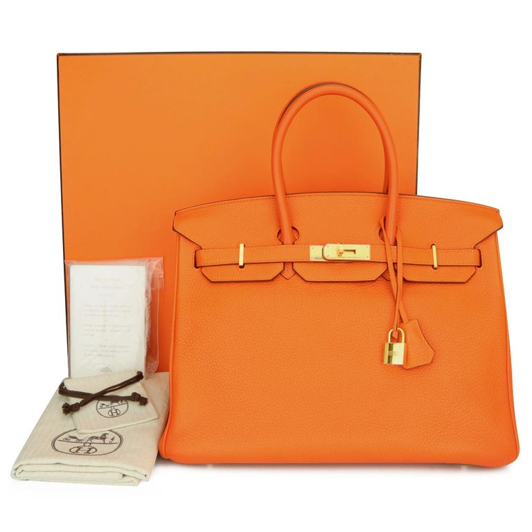 Authentic Hermès Birkin 35cm Orange Togo Leather with Gold Hardware Stamp N Year 2010.  This bag is still in mint condition. The bag still holds to the shape well. The hardware still very shiny and covered by the original protective