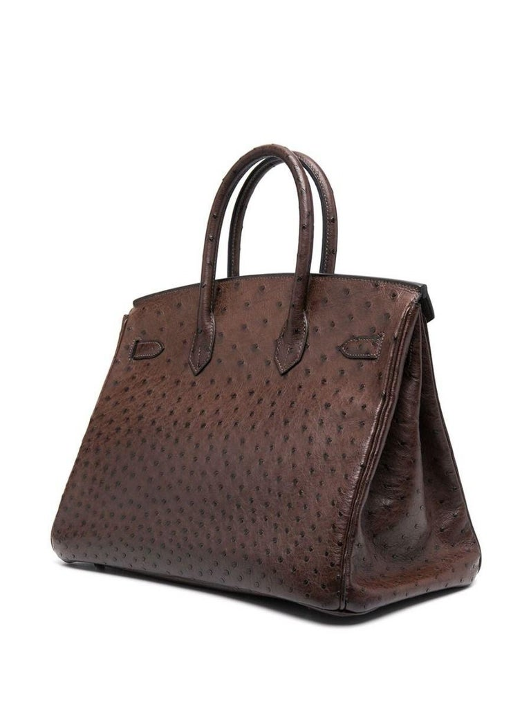 Adding a twist to the traditional Hermès Birkin, this truly spectacular, one-of-a-kind rarity showcases an earthy-brown toned exterior, crafted in ostrich skin. This leather is the rarest and most coveted of the exotic leathers, highly