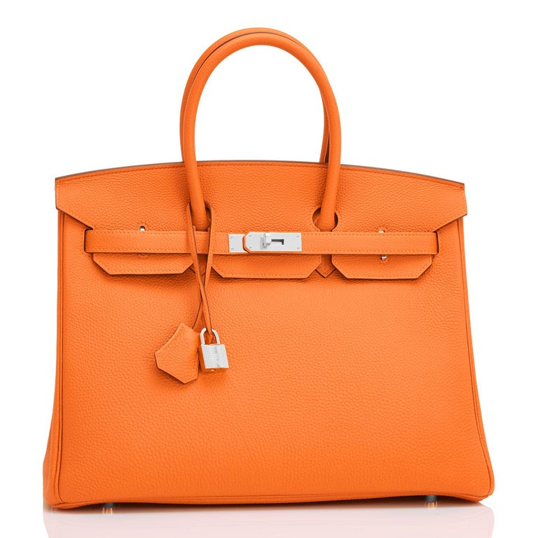Hermes Classic Orange Togo 35cm Birkin Bag Palladium Hardware  Extremely rare find in New or Never Worn condition (with plastic on hardware).  Comes in full set with lock, keys, clochette, sleeper, raincoat, and Hermes box.  This is the highly