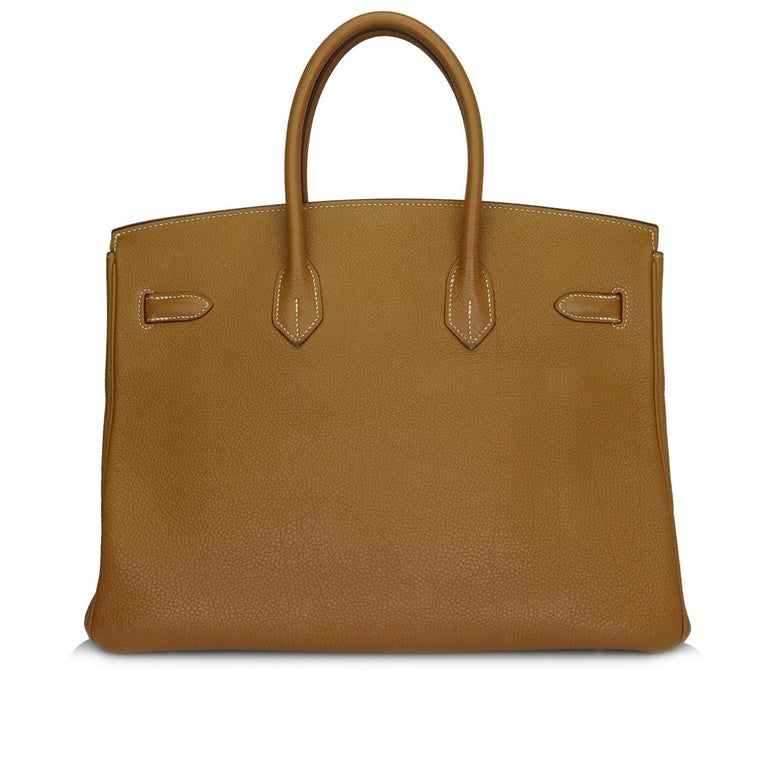 Hermès Birkin 35cm Gold Togo Leather with Palladium Hardware Stamp K_Year 2007.  This bag is still in good condition, it has been well looked after and the leather feels luxuriously soft. A truly stunning gold-brown colour combined with beautiful