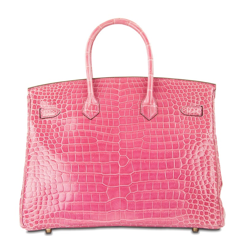 Incredibly rare Hermes 35cm Birkin in Pink Porosus Crocodile. This iconic special order Hermes Birkin bag is timeless and chic. Fresh and crisp with gold hardware.       Condition: New or Never Used     Made in France     Bag Measures: 35cm (13.8