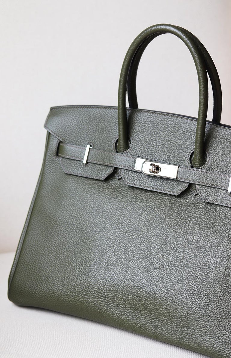 Hermès Birkin 35cm Togo-Leather Bag with Palladium hardware. Top handle strap. Tonal leather lining. Double slit pocket and zip pocket on interior walls. Turn-lock closure at front. Colour: Khaki (green). Comes with all dustbag, lock and key and