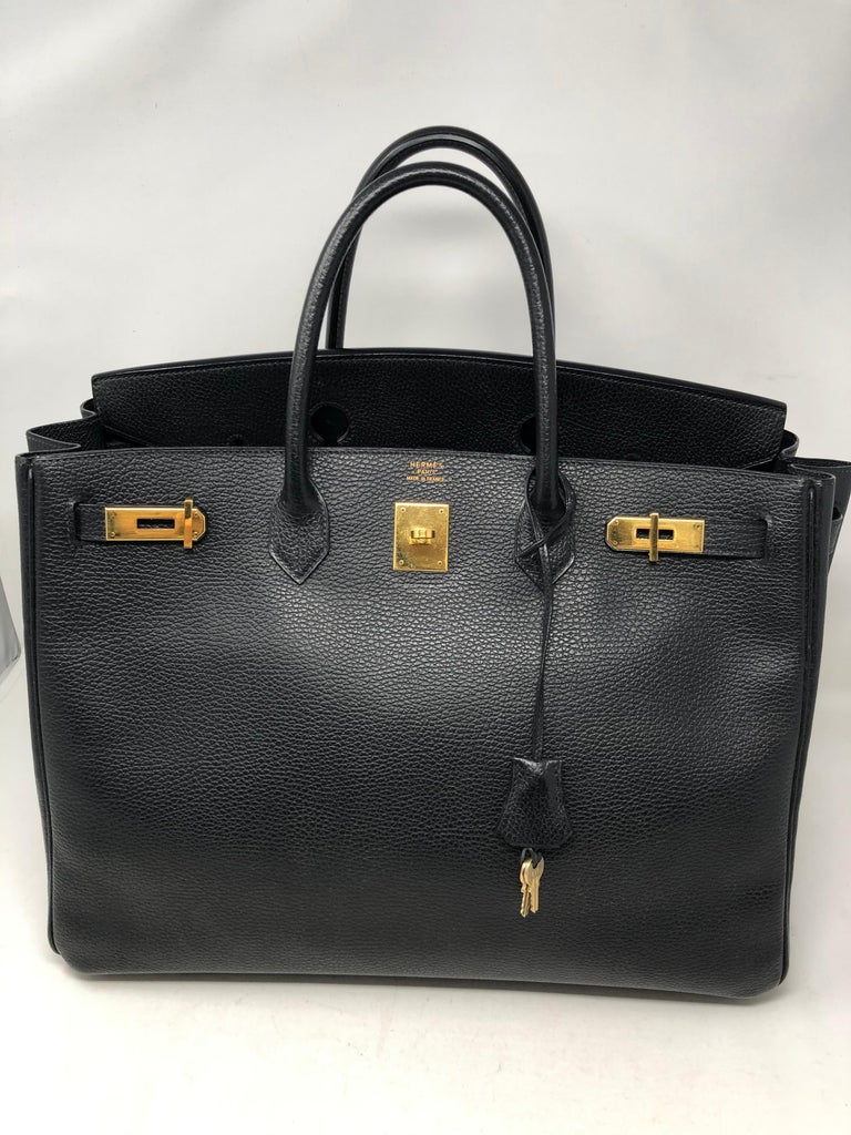 Hermes Black Birkin 40 Ardennes Leather. Gold hardware. Good condition for vintage. Retired size. Clean interior. Has great structure. Includes clochette, lock and keys. Hermes dustcover included. Guaranteed authentic.