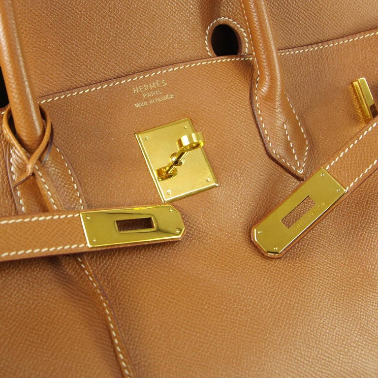 Leather Gold tone hardware Leather lining Date code present Made in France Handle drop 4