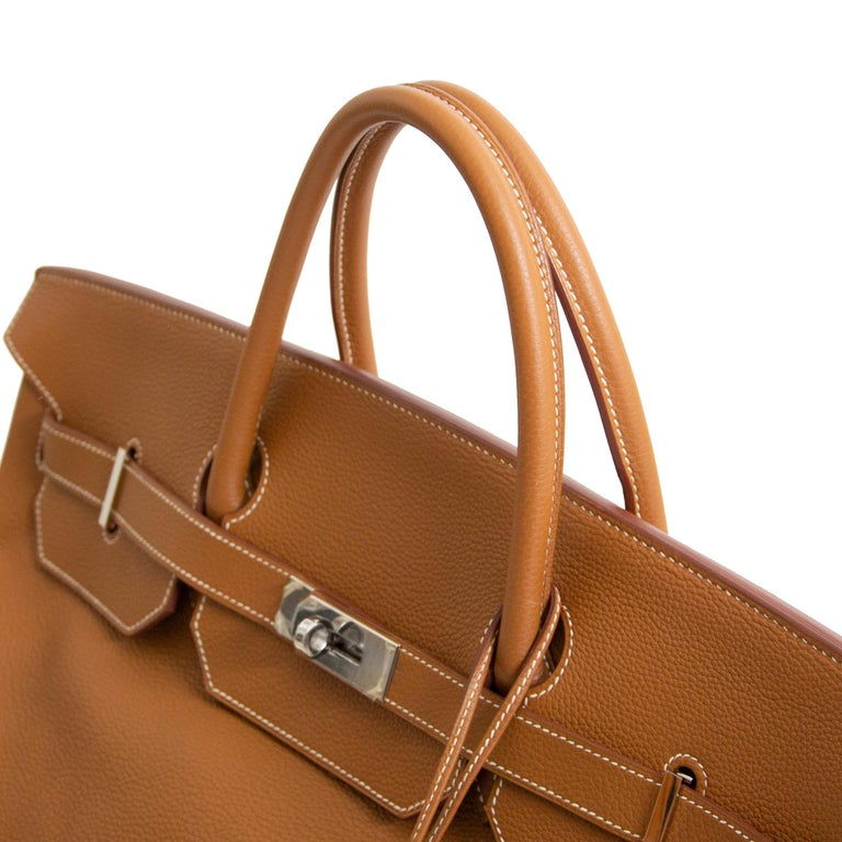 This GORGEOUS large Hermès Birkin bag is a true collectors piece. The bag is crafted out of Togo leather which is Hermès' most wanted leather. It's grainy yet smooth leather is almost 100% scratch resistant. The bag has a cool slouchy look yet it's