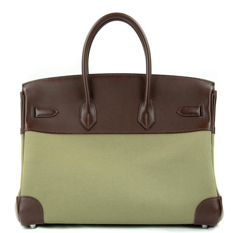 Hermes 35cm Birkin bag in Olive Toile Officier Canvas Chocolate. This iconic special order Hermes Birkin bag is timeless and chic. Fresh and crisp with palladium hardware.      Condition: New or Never Used     Made in France     Bag Measures: 35cm