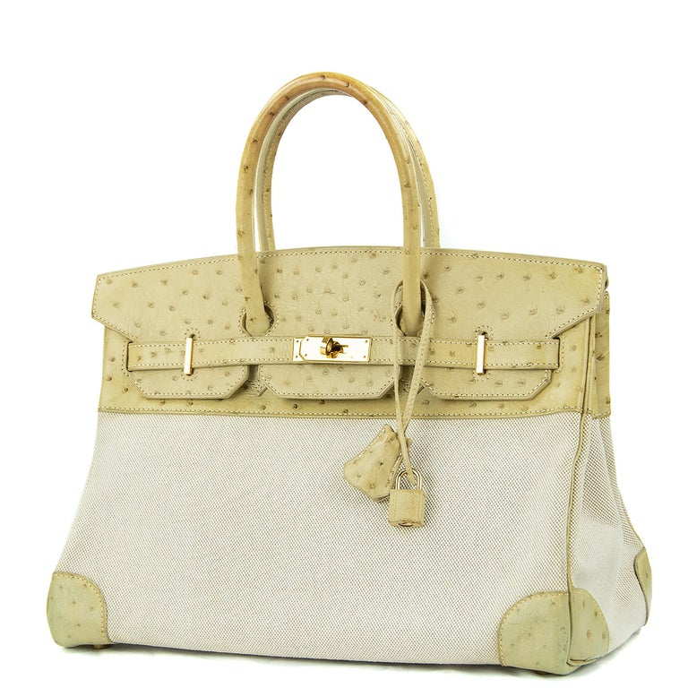 Hermes 35cm Birkin in Toile & Blanc Casse Ostrich. This iconic special order Hermes Birkin bag is timeless and chic. Fresh and crisp with gold hardware.      Condition: Excellent, Previously Owned     Made in France     Bag Measures: 35cm (13.8