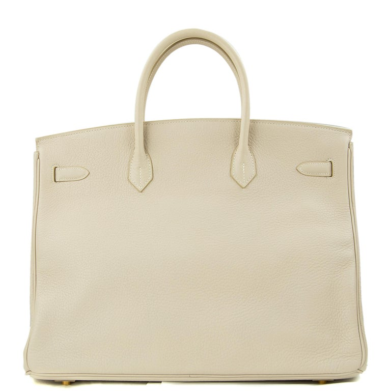 Hermes 40cm Birkin in Poudre Togo. This iconic special order Hermes Birkin bag is timeless and chic. Fresh and crisp with gold hardware.      Condition: New or Never Used     Made in France     Bag Measures: 40cm (15.7