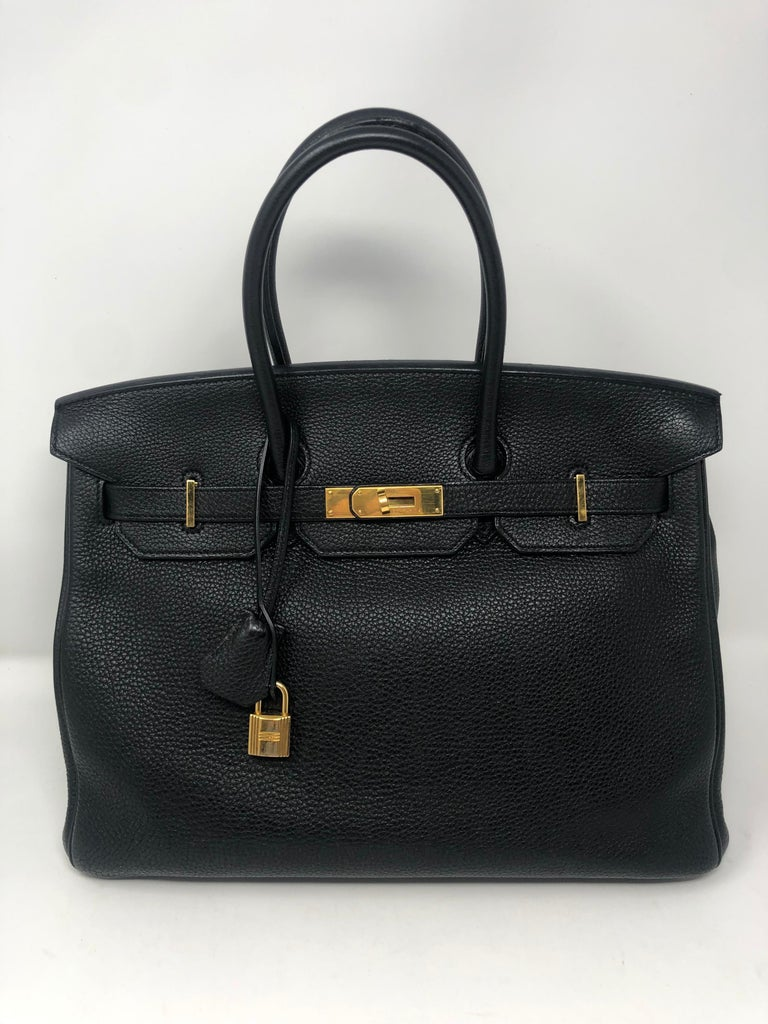 Hermes Black Birkin Togo 35 Gold hardware. Classic black color Birkin in most wanted togo leather. Has some wear on handles. Exterior and interior good condition. Guaranteed authentic.