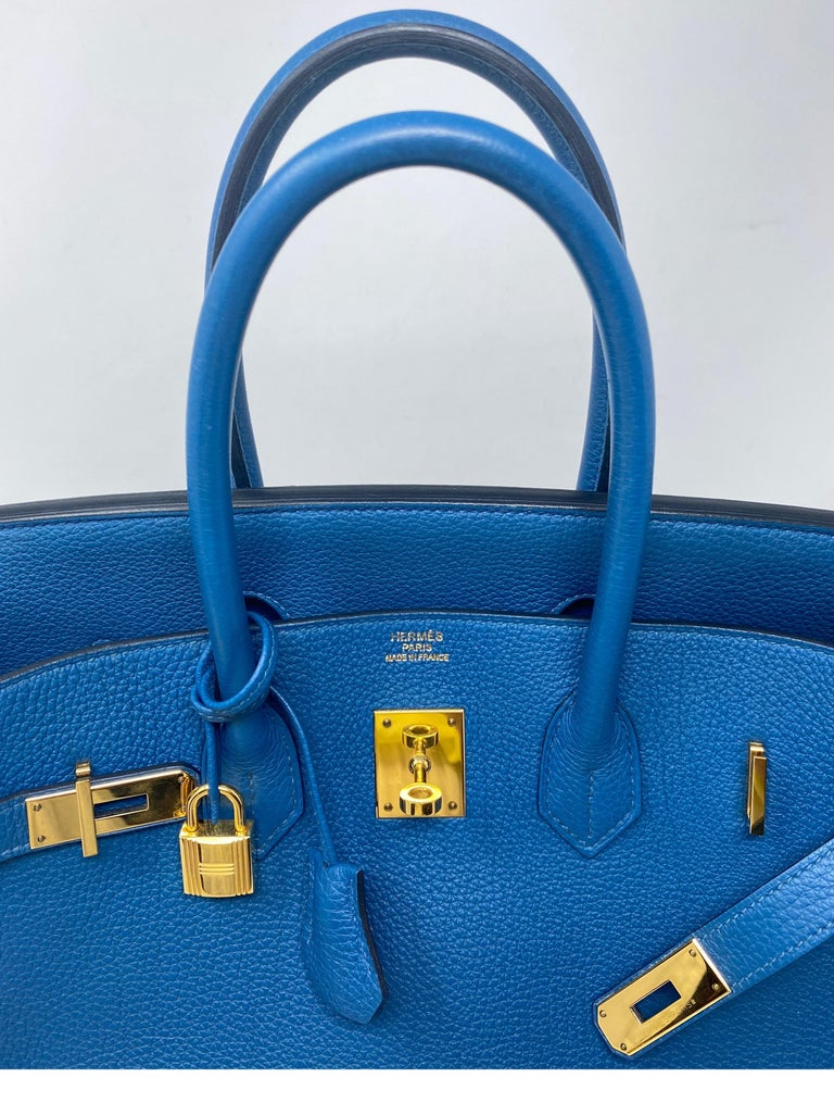 Hermes Birkin Bkue Colvert 35 Bag. Beautiful vibrant blue color. Gold hardware. Highly coveted combo. Excellent condition. Togo leather. Stunning bag. Won't last. Includes clochette, lock, keys, rain jacket, and dust cover. Guaranteed authentic.