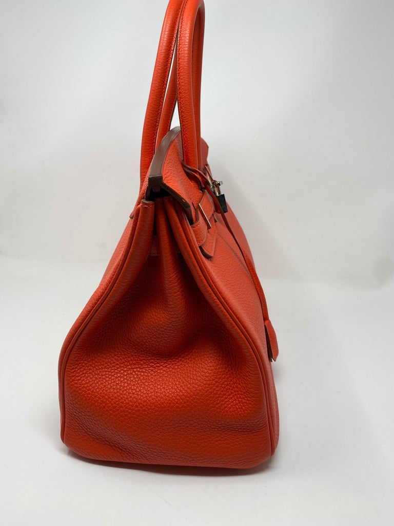Hemes Capucine Birkin 35 Bag. Mint condition like new Birkin. Bright poppy orange/ red color with togo leather. Palladium silver hardware. Plastic still on hardware. This bag was never used. Would make a great gift. Includes clochette, dust cover,