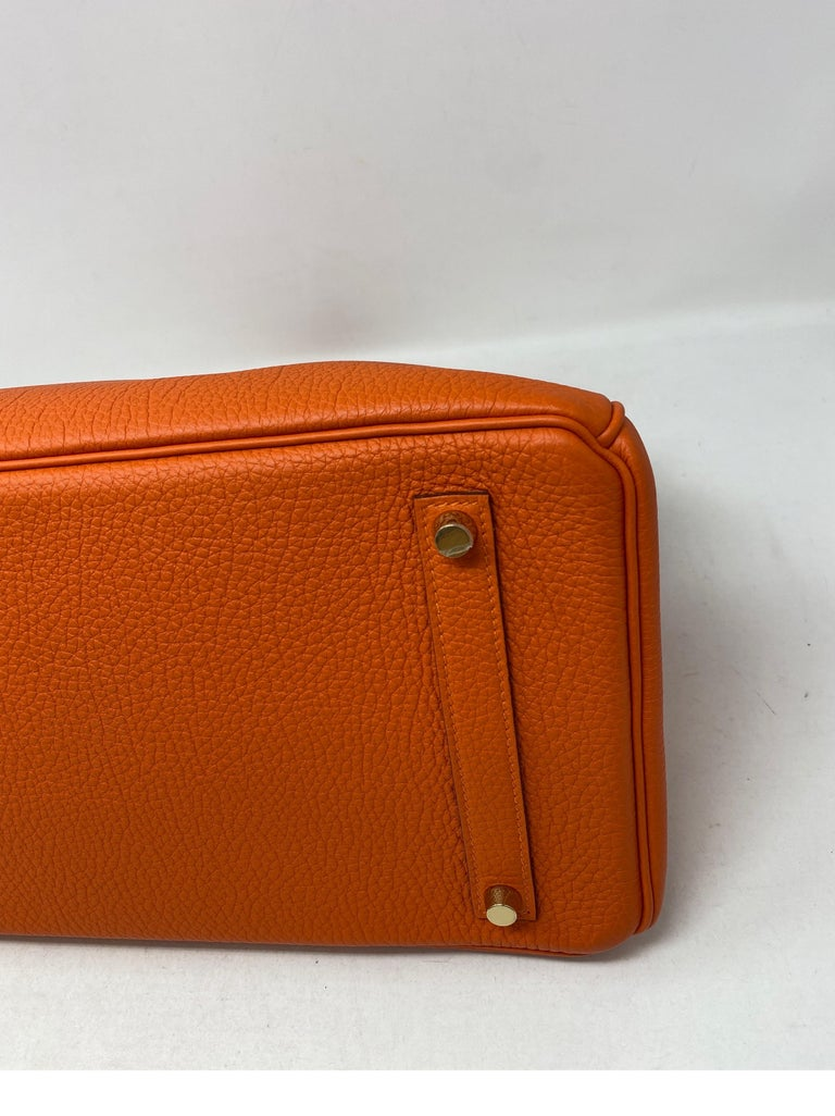Hermes Feu Orange Birkin 35 Bag. Brighter rare orange color with gold hardware. The most wanted combination. Looks like new condition. Beautiful Birkin Bag. Invest in the best. Includes clochette, lock, keys, and dust cover. Guaranteed authentic.