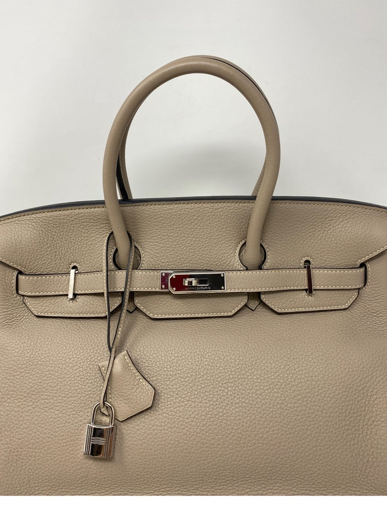 Hermes Griss Birkin 35. Light grey color with palladium hardware. Most wanted neutral color. Good condition. Togo leather. Don't miss out on this one. Includes clochette, lock, keys, and dust cover. Guaranteed authentic.