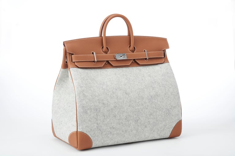 New, unworn limited edition Hermes Birkin HAC 50cm TODOO in Gold Togo leather and Gris Clair Wool Felt and palladum hardware.    This bag is the perfect travel companion - the 50cm size makes it a practical and stylish carry on and the durable wool