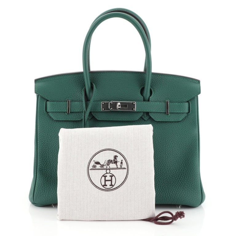 This Hermes Birkin Handbag Malachite Togo with Palladium Hardware 30, crafted in Malachite green Togo leather, features dual rolled handles, frontal flap, and palladium hardware. Its turn-lock closure opens to a Malachite green Chevre leather