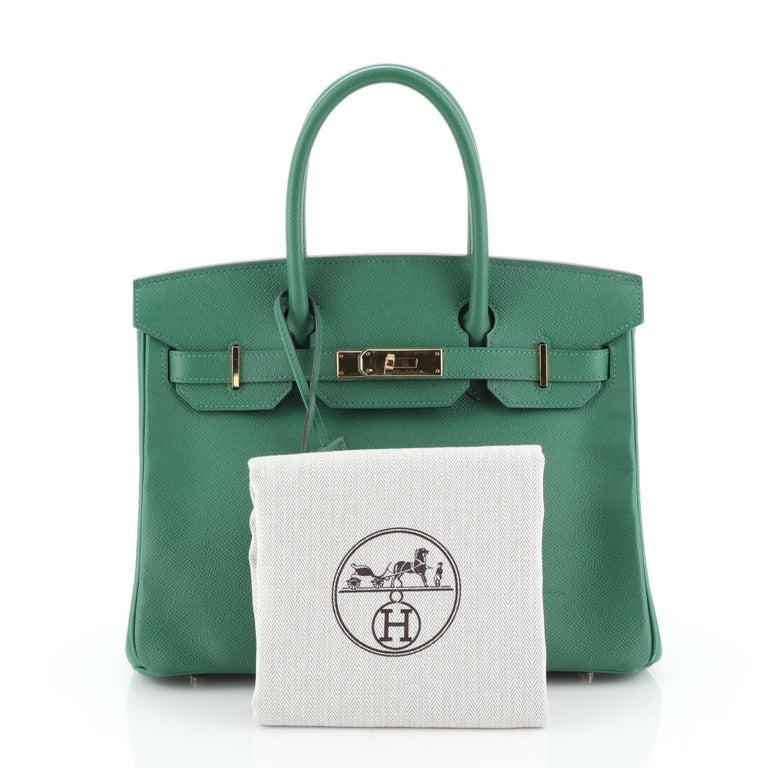 This Hermes Birkin Handbag Vert Vertigo Epsom with Gold Hardware 30, crafted in Vert Vertigo green Epsom leather, features dual rolled handles, frontal flap, and gold hardware. Its turn-lock closure opens to a Vert Vertigo green Chevre leather