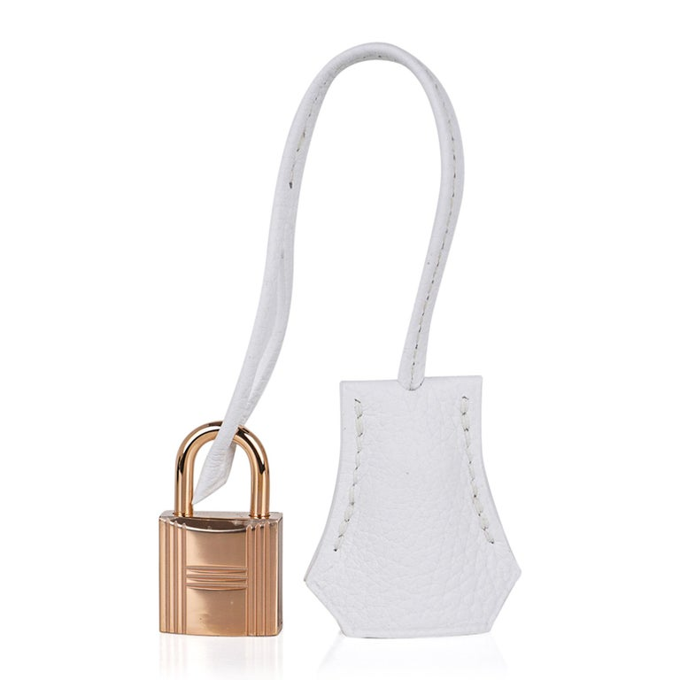 Mightychic offers a guaranteed authentic Hermes Birkin HSS 25 Special Order bag featured in Craie and White. This subtle colour combination brings you one of the most beautiful HSS bags. Chic crisp bag in clemence leather. Accentuated with coveted