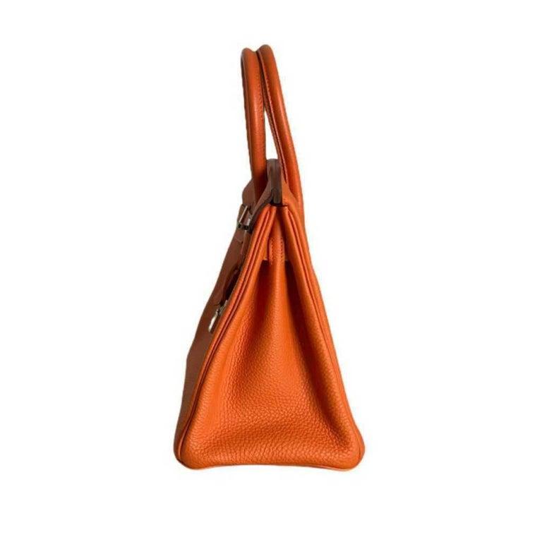 - Designer: HERMÈS - Model: Birkin - Condition: Very good condition. - Accessories: Padlock, Keys - Measurements: Width: 30 cm, Height: 22cm, Depht: 16 cm - Exterior Material: Leather - Exterior Color: Orange - Hardware Color: Silver - Serial