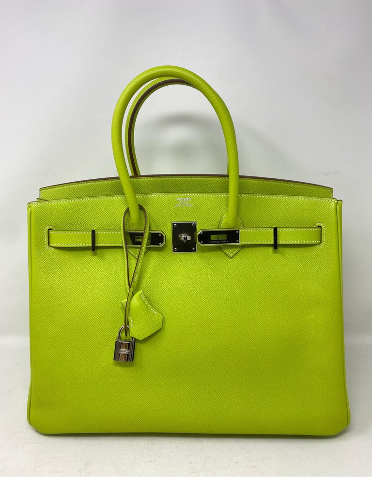 Hermes Birkin Kiwi Candy Birkin 35. Green interior leather. Palladium hardware. Mint condition. Like new. Beautiful bright lime color in Epsom leather. Rare combo. Includes clochette, lock, keys, and dust bag. Guaranteed authentic.