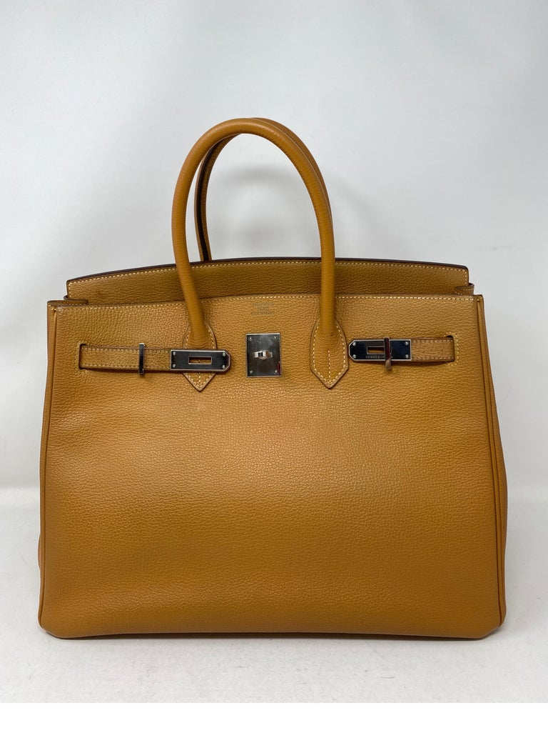 Hermes Birkin 35 Natural Bag. Tan neutral color. Vintage Birkin from 2006 in fair to good condition. Looks great for its age. Light wear throughout. Handles have a little wear. Please see all photos.