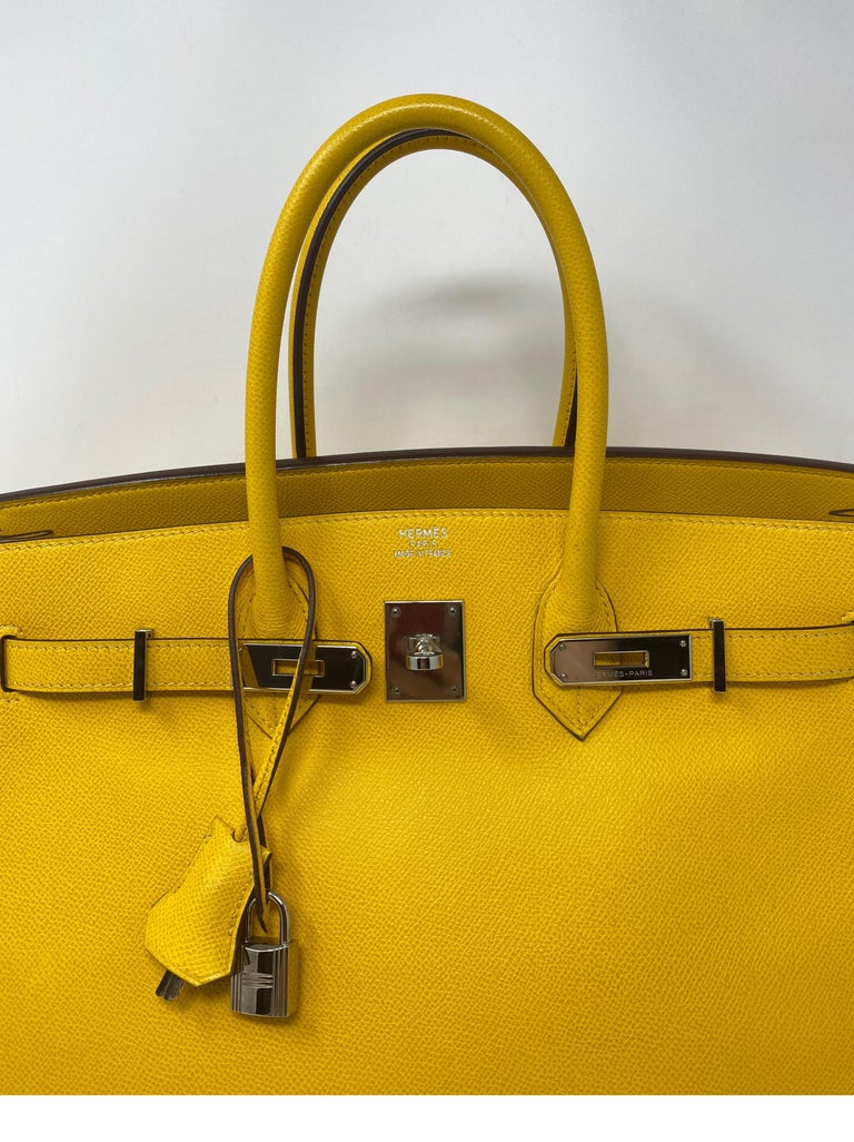 Hermes Birkin Soleil Yellow 35 Bag. Palladium hardware. Epsom leather. Mint condition. Like new condition. Beautiful bright yellow color. From 2005. Includes clochette, lock, keys, and dust cover. Guaranteed authentic.