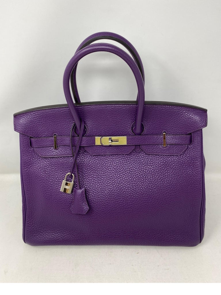 Hermes Ultraviolet Birkin 35 Bag. Palladium hardware. From 2012. P stamp. Excellent condition. Still has plastic on hardware. Vibrant purple color. Includes clochette, lock, keys, rain jacket and dust cover. Includes authenticity certificate.