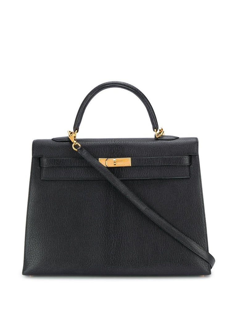 Crafted in France from pure black Chevre de Coromandel, a soft goat hide leather, popular for its lightweight and scratch-resistant texture, this pre-loved, 35cm Kelly Sellier bag features a medium, round top-handle, an adjustable crossbody shoulder