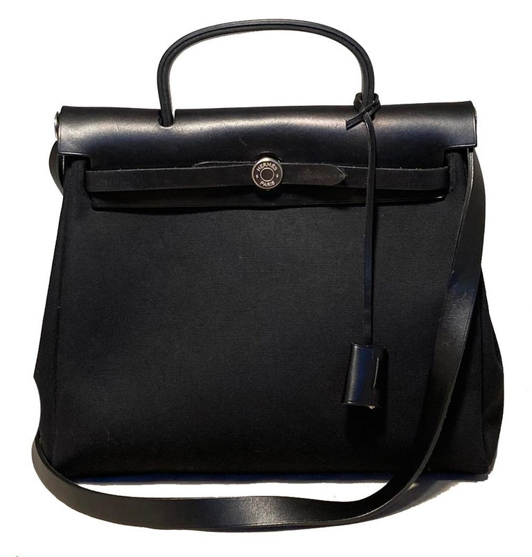 Interchangeable black and beige canvas herbag tote in good condition. Black barenia leather trim and brushed silver palladium hardware. Two bags in one as the leather upper and hardware can easily be changed to fit either canvas body. very good