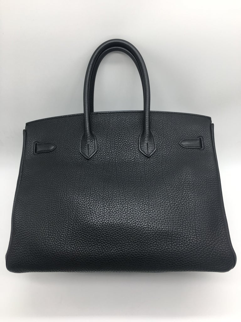 A 35cm black Hermes Birkin handbag in Togo Leather with Palladium Hardware. The classic bag for absolute elegance!  Full measurements are 35cm x 25cm high x 18cm deep. The handles are 10cm high. It's in excellent condition, the only signs of use