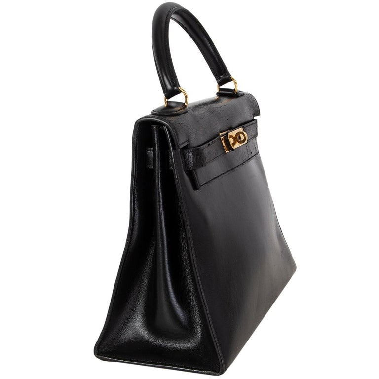 Hermes 'Kelly l 28 Sellier' bag in black Veau Box leather. Vintage 1970. Lined in leather with two open pockets against the front and an open pocket against the back. Has been carried and shoulders show dryness, minimal wear to the corners, the