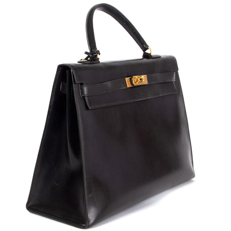 100% authentic Hermes 'Kelly 35 Sellier' in Noir (black) Veau Box leather with gold-plated hardware. Lined in black Chevre (goatskin) with two open pockets against the front and a zipper pocket against the back. Vintage 1981. Has been carried some