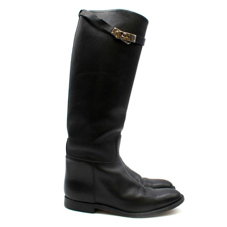 Hermes, Box Calfskin Riding Boot with iconic palladium plated buckle  - Twist Lock Strap buckle - Made in France  Please note, these items are pre-owned and may show signs of being stored even when unworn and unused. This is reflected within the