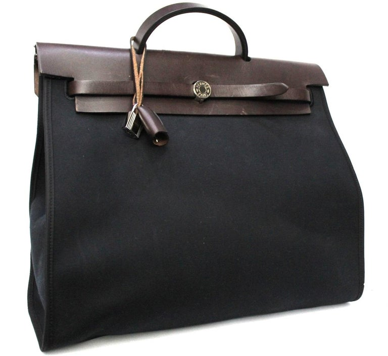 The Hermes Herbag Zip 39 Bag is a gorgeous every day bag and a must-have for Hermes lovers. This bag features durable toile canvas and natural calfskin leather. Like other Hermes bags such as the Kelly and Birkin, the Herbag has a clean, elegant
