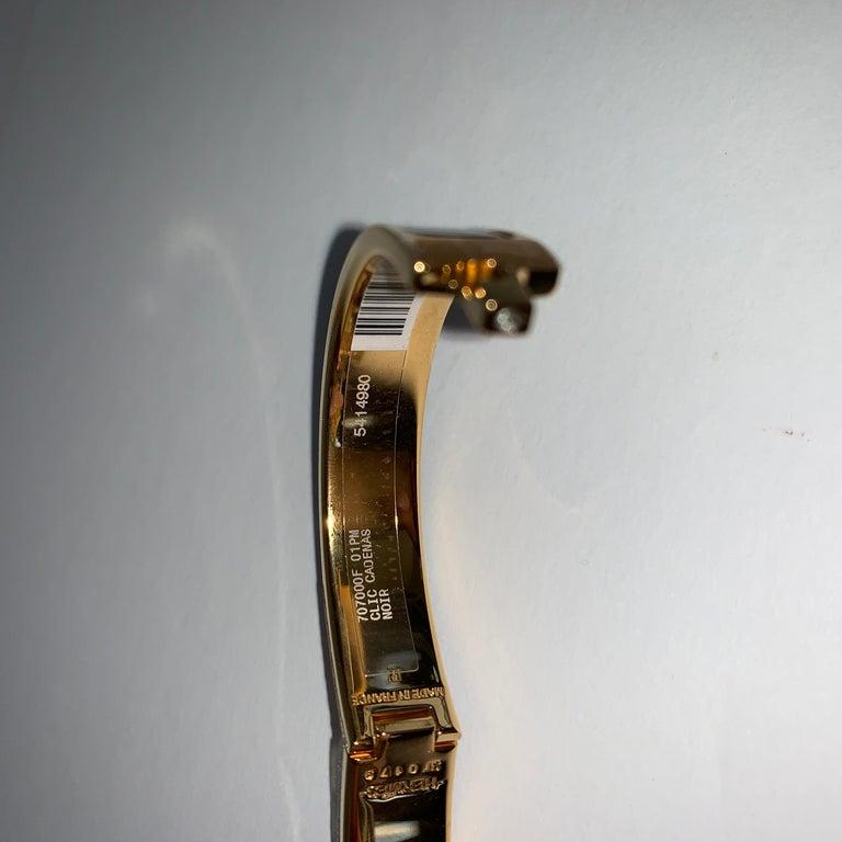 Women's or Men's Hermes Black Clic Cadenas Enamel Lock Bracelet Gold For Sale