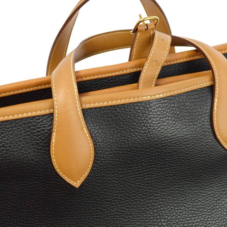 Hermes Black Cognac Leather Men's Women's Garment Carryall Top Handle Travel Tote Bag  Leather Woven lining Gold tone hardware Zipper and buckle closures Made in France Handle drop 5