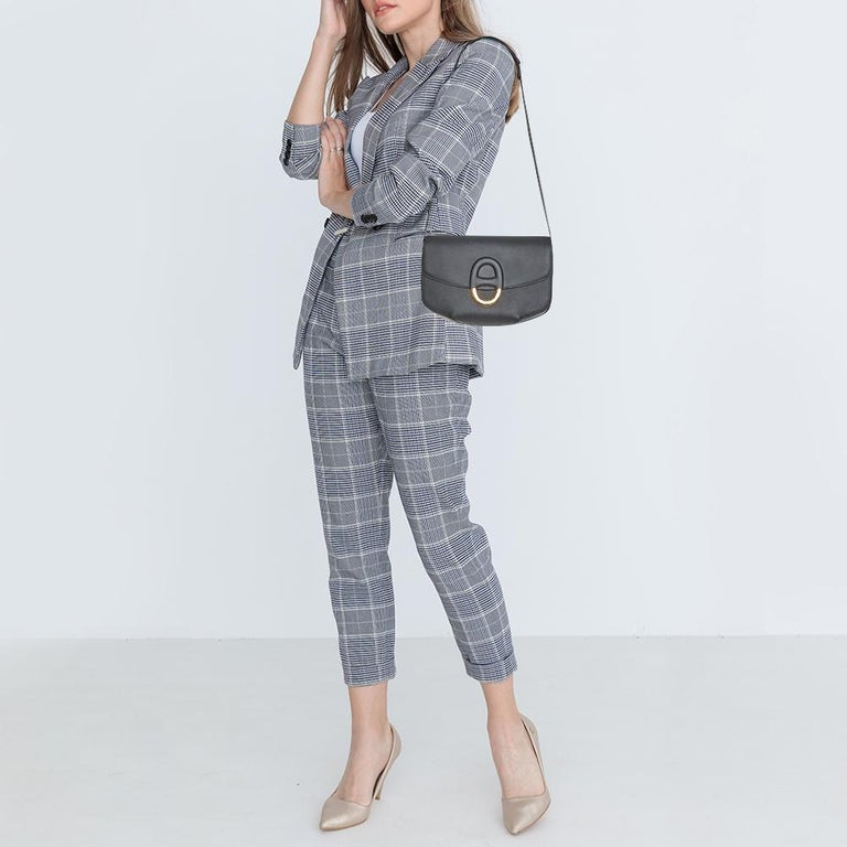 This enchanting and beautifully shaped Epsom leather handbag is surely a must-have. With a leather-lined interior, this Cherche bag is in style. Remarkable for its brilliant design, this handbag from Hermes will upgrade your style quotient. It has