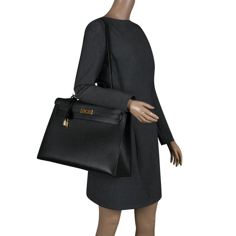 Get set go in this stylish and elegant Hermes leather bag. With a durable leather interior, this is the perfect companion for you. Made beautifully, it comes in an exquisite black color and is waiting for it to be grabbed.  Includes: The Luxury